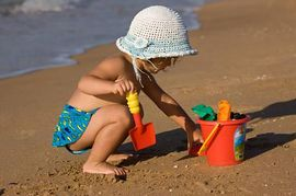 child playing in the sand 2